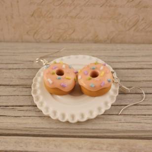 Oranžové donutky s barevným sypáním
